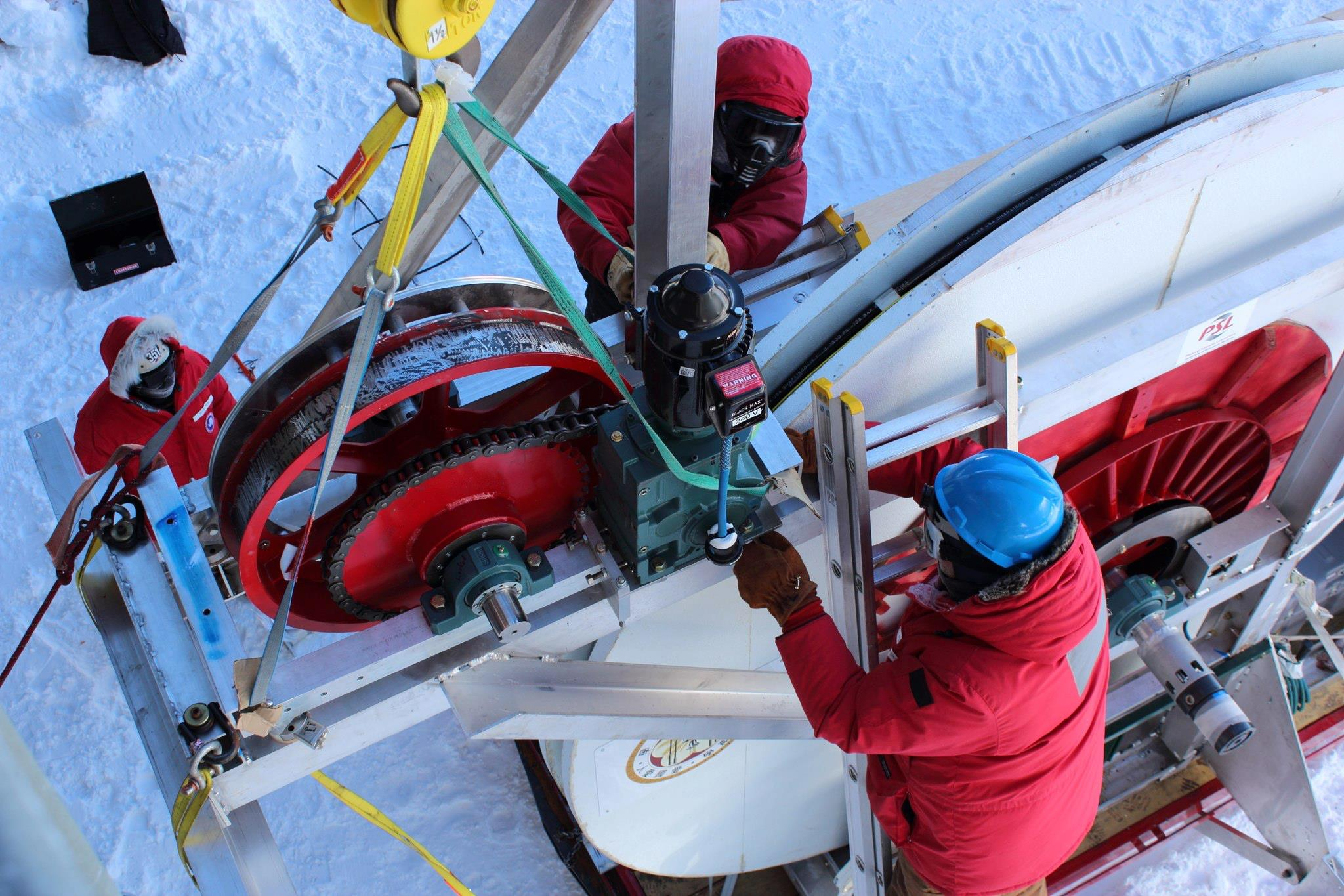 ARA construction at the South Pole, 2012-2013 season. The drill hose reel is being connected.